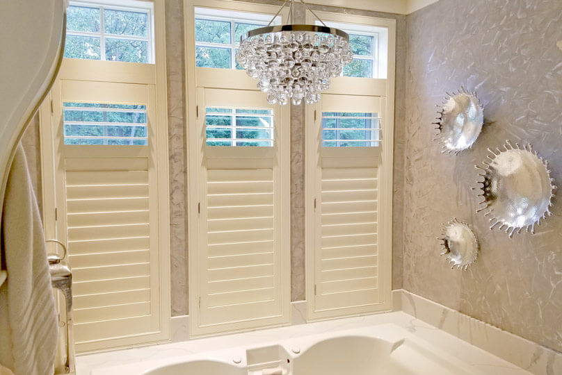 White plantation shutters in a bathroom